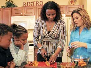 Cat Cora shows Robin how to prepare healthy family meals.