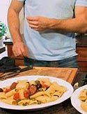 Rigatoni with Spicy Italian Salami, Oven-Roasted Tomatoes, Olives and Capers