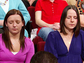 Audience members practice Montel Williams' breathing exercise.