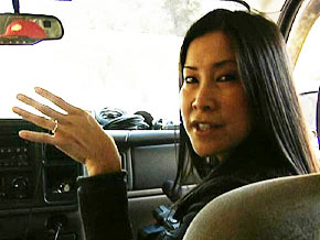 Lisa Ling watches as officers storm a suspected child pornographer's home.