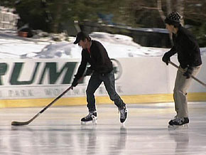 Michael J. Fox and Dr. Oz go ice-skating in New York's Central Park.