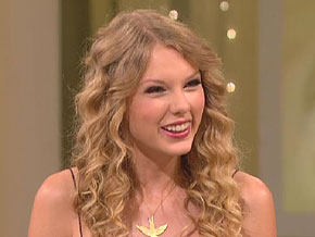 Taylor Swift says she tries to maintain a normal attitude.