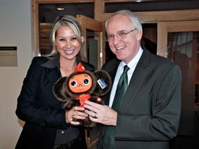 Anna Kournikova presents the U.S. Ambassador with Cheburashka, a Russian animation toy.