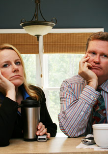 Depressed couple at breakfast
