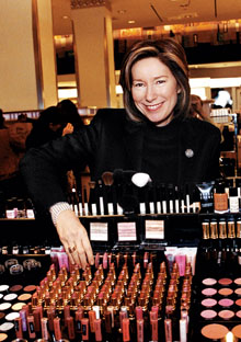 Valerie Monroe behind the Bobbi Brown makeup counter